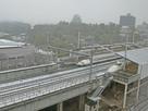 ホテルから見た雪景色の新幹線と福山城…